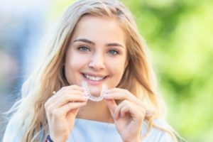happy young woman with Invisalign